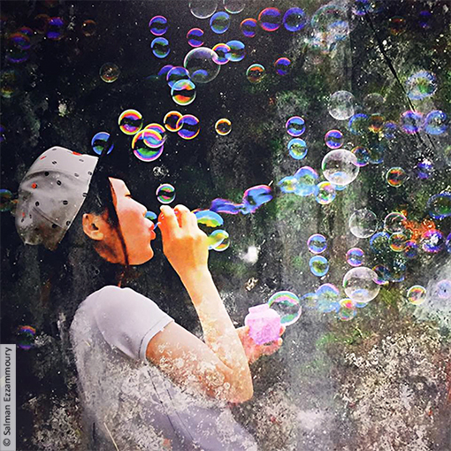 The girl and the colored soap bubbles